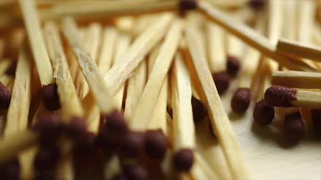 pétala : Macro dolly video of scattered matches Stock Footage