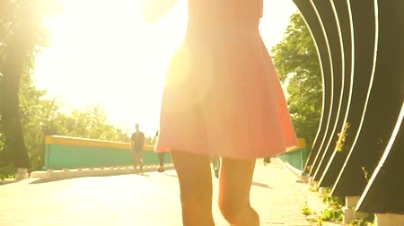 брюнет : Beautiful brunette girl in pink dress runs though arched passage. Slow motion steadicam clip