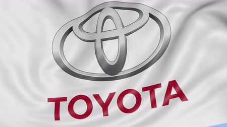 car logo : Close up of waving flag with Toyota logo, seamless loop, blue background. Editorial animation. Stock Footage