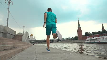 muži : Athletic male running against Moscow Kremlin. Super slow motion steadicam video 240 fps