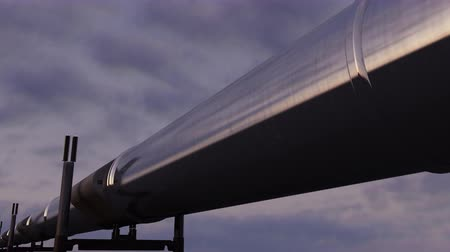boru hattı : Shiny pipeline against evening cloudy sky. Dolly shot. 4K seamless loopable animation Stok Video