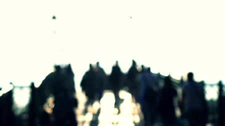 blur : Unrecognizable blurred people walking. 4K bokeh shot. Back light Stock Footage