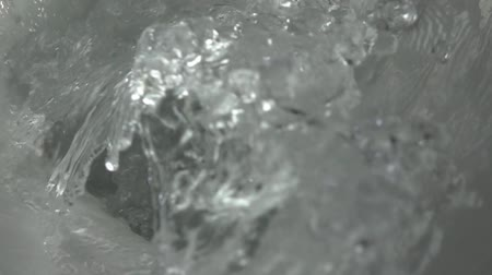 pour out : Super slow motion shot of water being flushed in a toilet bowl, 500 fps Stock Footage