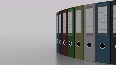 corporate affairs : Colored office binders rotation. 4K seamless loopable clip
