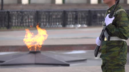 muhterem : Memorial fire and armed soldier. Super slow motion long shot