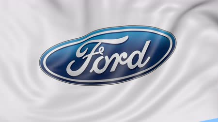 car logo : Close up of waving flag with Ford Motor Company logo, seamless loop, blue background. Editorial animation. Stock Footage