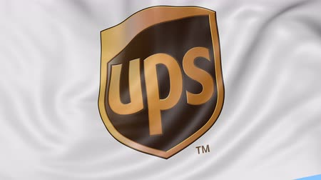 loga : Close up of waving flag with United Parcel Service UPS logo, seamless loop, blue background. Editorial animation. Dostupné videozáznamy