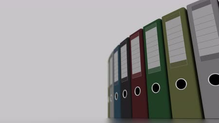 segregator : Rotating colored office binders for reports and presentations. 4K seamless loopable clip, shallow focus