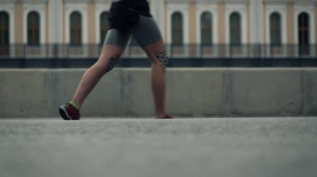 famous pace : Feet of city marathon runners. Competition concept. Slow motion long shot