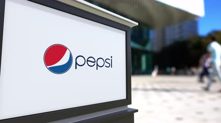 pepsico : Street signage board with Pepsi logo. Blurred office center and walking people background. Editorial  3D rendering Stock Footage