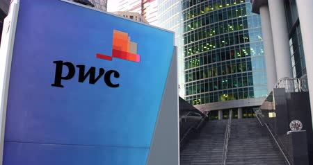 pwc : Street signage board with PricewaterhouseCoopers PwC logo. Modern office center skyscraper and stairs background. Editorial 4K 3D rendering