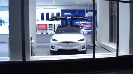 tesla car : VIENNA, AUSTRIA - DECEMBER, 24 Steadicam shot of new luxury Tesla Model X electric car and showroom at night. Stock Footage