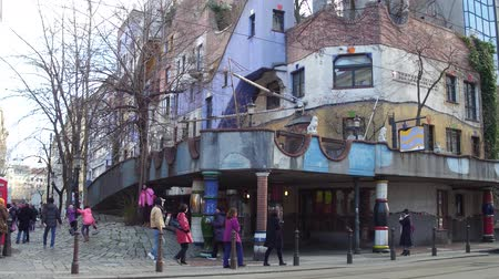 expressionism : VIENNA, AUSTRIA - DECEMBER, 24 Tourists taking photos near famous expressionist Hundertwasser House Stock Footage