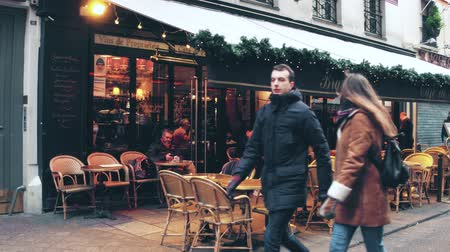 PARIS, FRANCE - DECEMBER, 31, 2016. Steadicam walk along beautiful Parisian brasserie, small restaurant, with awnings. Stok Video