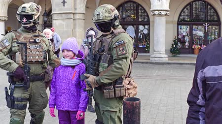 bulletproof : KRAKOW, POLAND - JANUARY, 14, 2017 Armed special force soldiers posing with civilians with Polish and American flags at WOSP military show.