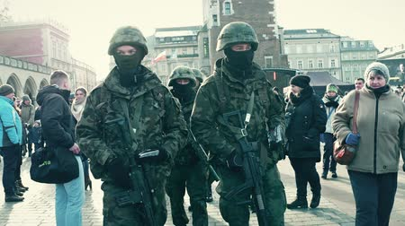 bulletproof : KRAKOW, POLAND - JANUARY, 14, 2017 Polish special force soldiers walk at WOSP military show. Stock Footage