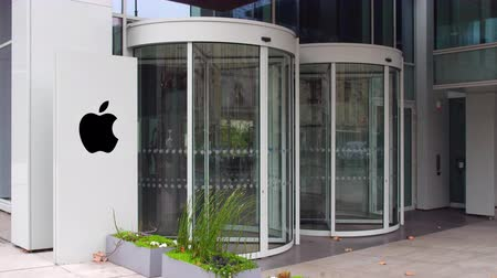 apple headquarter : Street signage board with Apple Inc. logo. Modern office building entrance.