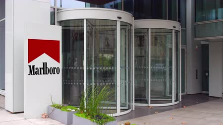 richmond : Street signage board with Marlboro logo. Modern office building.