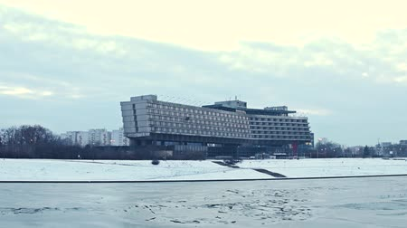 wisla : KRAKOW, POLAND - JANUARY, 14, 2017 Forum Hotel and river Vistula embankment in winter. Stock Footage