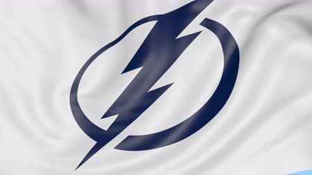 tampa bay : Close-up of waving flag with Tampa Bay Lightning NHL hockey team logo, seamless loop, blue background. Editorial animation. Stock Footage
