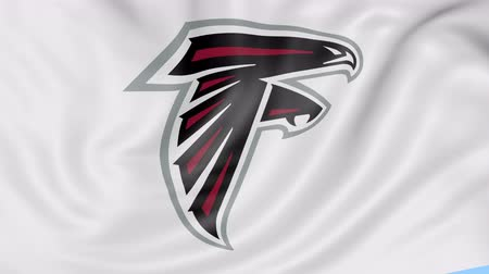 super bowl : Close-up of waving flag with Atlanta Falcons NFL American football team logo, seamless loop, blue background. Editorial animation.