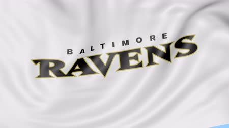 super bowl : Close-up of waving flag with Baltimore Ravens NFL American football team logo, seamless loop, blue background. Editorial animation. 4K Stock Footage