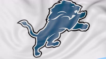 super bowl : Close-up of waving flag with Detroit Lions NFL American football team logo, seamless loop, blue background. Editorial animation. Stock Footage