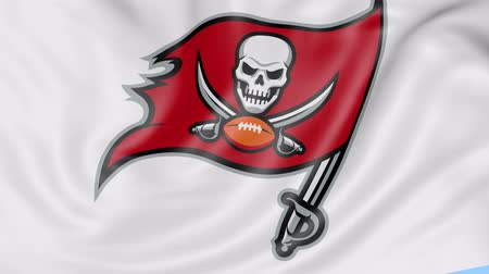 tampa bay : Close-up of waving flag with Tampa Bay Buccaneers NFL American football team logo, seamless loop, blue background. Editorial animation.
