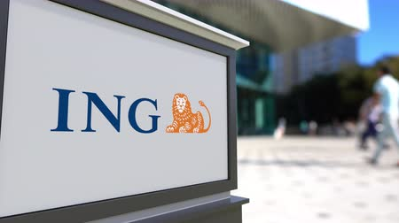 ing : Street signage board with ING Group logo. Blurred office center and walking people background. Editorial 3D rendering Stock mozgókép
