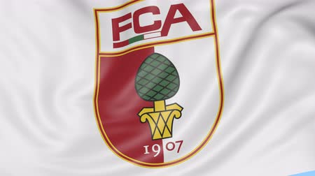 augsburg : Close-up of waving flag with FC Augsburg football club logo, seamless loop, blue background. Editorial animation.
