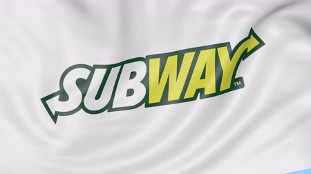 franczyza : Close-up of waving flag with Subway logo, seamless loop, blue background, editorial animation. Wideo