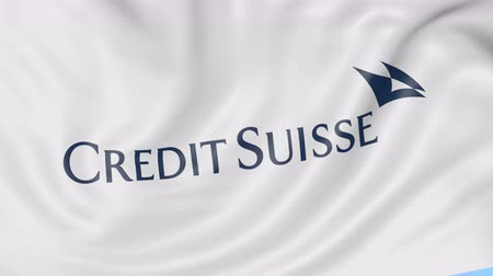 credit suisse : Close-up of waving flag with Credit Suisse Group logo, seamless loop, blue background, editorial animation. Stock Footage