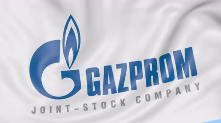 gazprom : Close-up of waving flag with Gazprom logo, seamless loop, blue background, editorial animation.