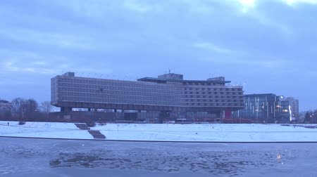 wisla : KRAKOW, POLAND - JANUARY, 14, 2017 Forum Hotel and river Vistula embankment in winter. steadicam video