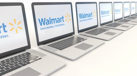 walmart : Modern laptops with Walmart logo. Computer technology conceptual editorial clip, seamless loop