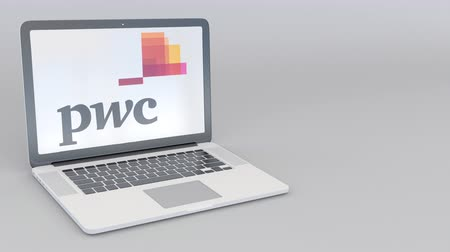pwc : Rotating opening and closing laptop with PricewaterhouseCoopers PwC logo. Computer technology conceptual editorial