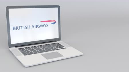 ba : Rotating opening and closing laptop with British Airways logo. Computer technology conceptual editorial clip