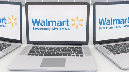 walmart : Laptops with Walmart logo on the screen. Computer technology conceptual editorial clip, seamless loop