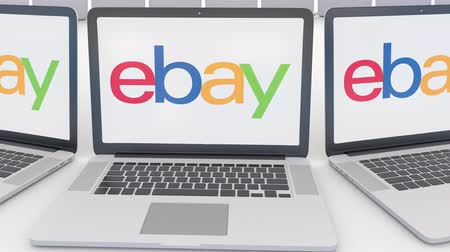 ebay : Laptops with eBay Inc. logo on the screen. Computer technology conceptual editorial