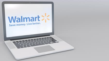 walmart : Opening and closing laptop with Walmart logo on the screen. Computer technology conceptual editorial clip