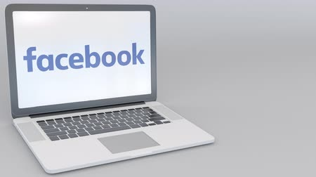 loga : Opening and closing laptop with Facebook logo on the screen. Computer technology conceptual Dostupné videozáznamy