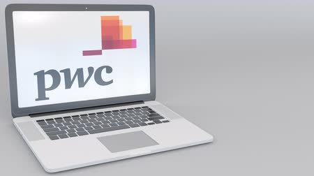 pwc : Opening and closing laptop with PricewaterhouseCoopers PwC logo on the screen. Computer technology conceptual editorial clip