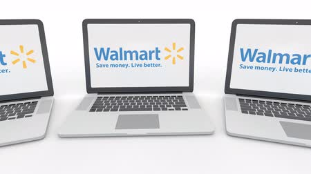 walmart : Notebooks with Walmart logo on the screen. Computer technology conceptual editorial Stock Footage