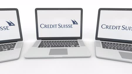 credit suisse : Notebooks with Credit Suisse Group logo on the screen. Computer technology conceptual editorial clip, seamless loop