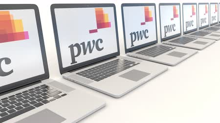 pwc : Modern laptops with PricewaterhouseCoopers PwC logo. Computer technology conceptual editorial  clip, seamless loop