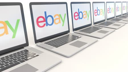 ebay : Modern laptops with eBay Inc. logo. Computer technology conceptual editorial