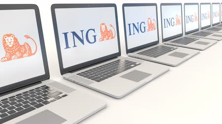 ing : Modern laptops with ING Group logo. Computer technology conceptual editorial