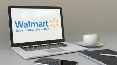 walmart : Opening laptop with Walmart logo on the screen. Modern workplace conceptual editorial Stock Footage