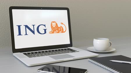 ing : Opening laptop with ING Group logo on the screen. Modern workplace conceptual editorial Stock mozgókép