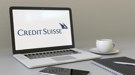 credit suisse : Opening laptop with Credit Suisse Group logo on the screen. Modern workplace conceptual editorial